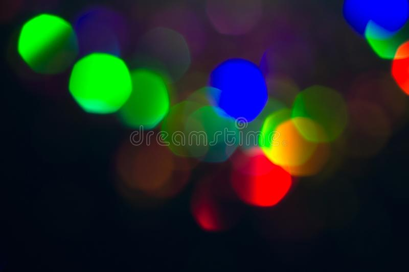 Colorful circles of light abstract background. Holiday texture. Glitter multicolored light spots on dark backdrop, stock photography