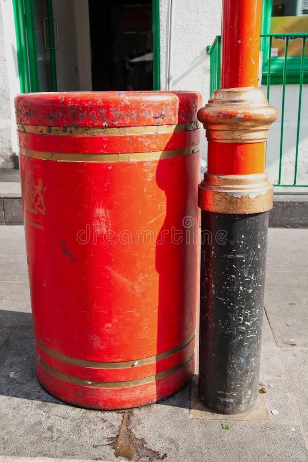 Colorful city litter bin and lamp post royalty free stock images
