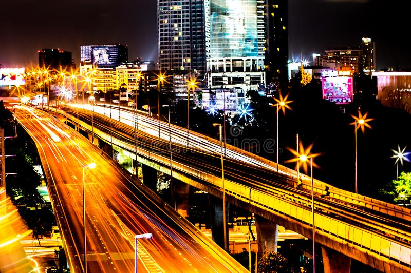 Colorful of city modern buildings night and road light abstract stock image