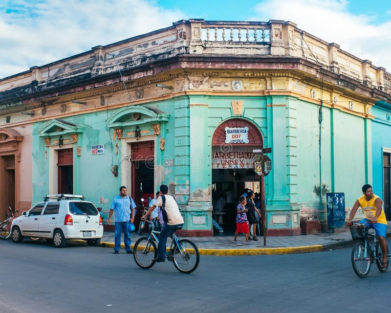 Colorful city scene in Managua Nicaragua. A colorful city street in Managua Nicaragua in Central America with bikers royalty free stock photos