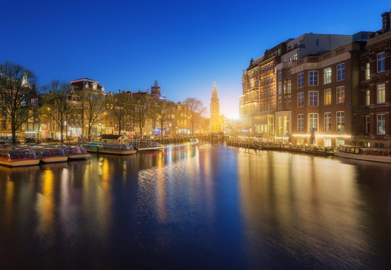 Colorful cityscape at sunset in Amsterdam, Netherlands stock images