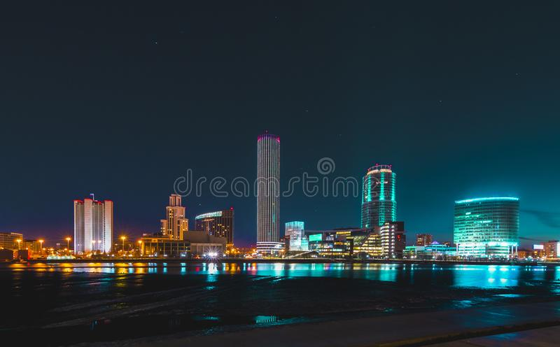 Colorful cityscape of Yekaterinburg at night reflecting in water stock photography