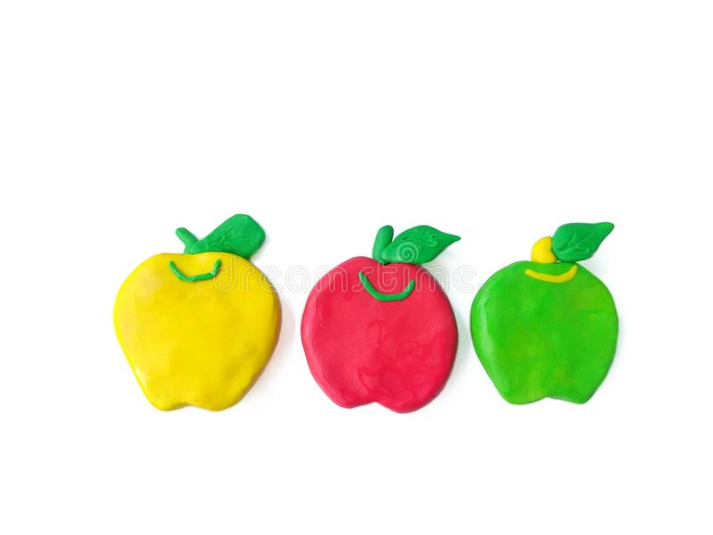 Colorful clay plasticine, delicious apple handmade, cute different fruit dough stock image