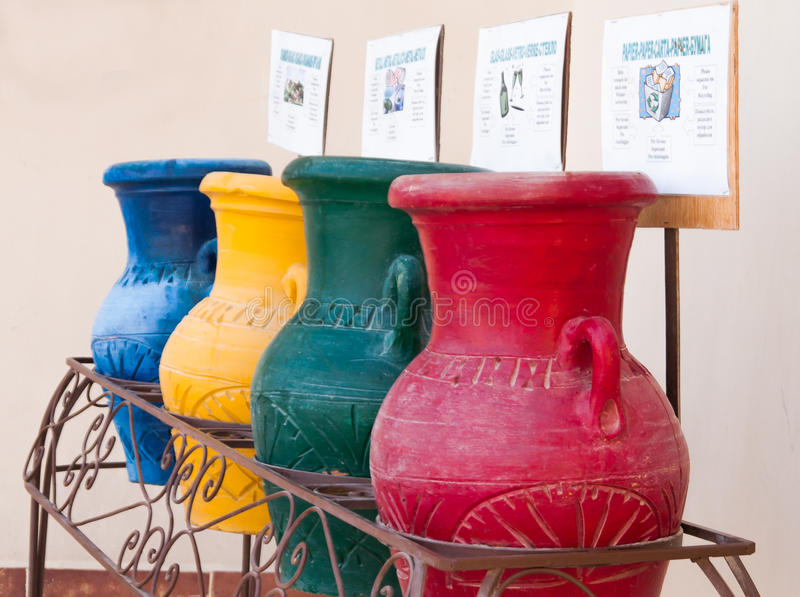 Colorful clay pots in a trash can at the hotel in Hurghada, Egypt royalty free stock photography