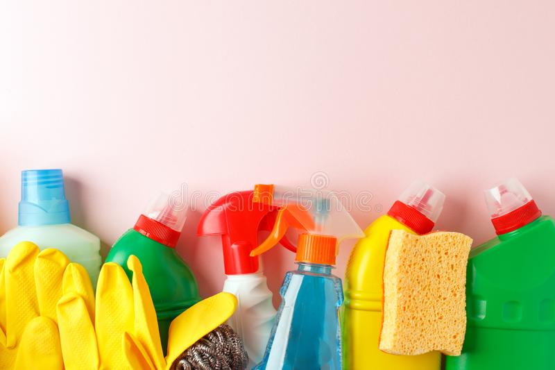 Colorful cleaning set for different surfaces in kitchen, bathroom, other rooms. Copy space for text or logo on pink background. royalty free stock image