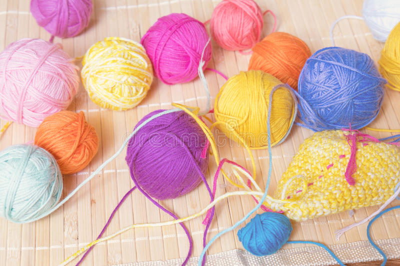 Colorful clews yarn and crochet hook. On wooden background. Toned and processing photos stock photos