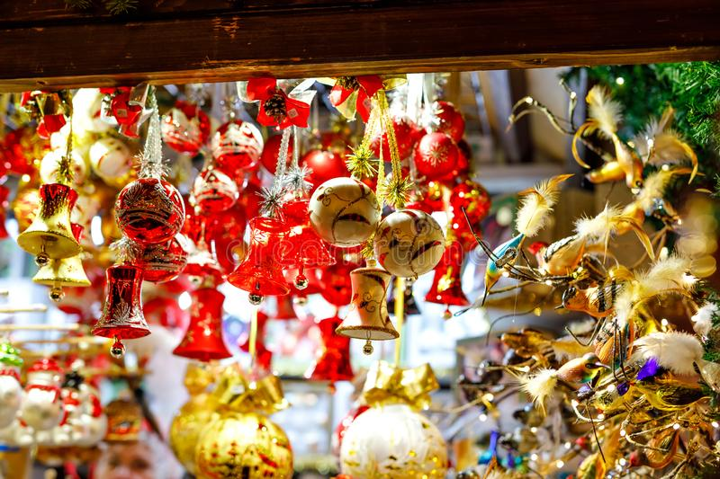 Colorful close up details of christmas fair market. Balls decorations for sales. Xmas market in Germany with traditional stock images
