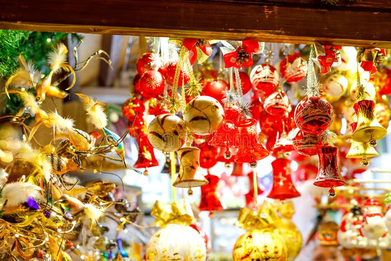 Colorful close up details of christmas fair market. Balls decorations for sales. Xmas market in Germany with traditional stock photography