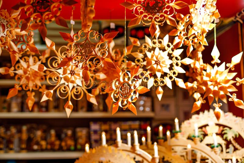 Colorful close up details of christmas fair market. Wooden selfmade stars decorations for sales. Xmas market in Germany royalty free stock photos
