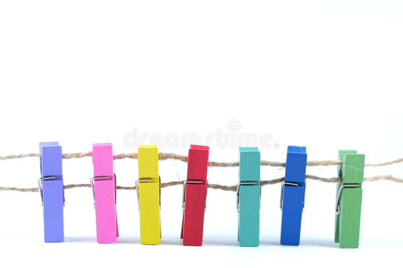 Colorful Clothespins on white background stock photos