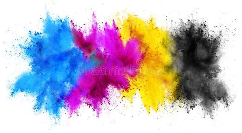 Colorful CMYK cyan magenta yellow key holi paint color powder explosion print concept isolated white background. Colorful CMYK cyan magenta yellow key holi paint royalty free stock photos