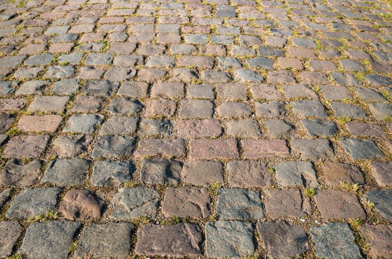 Colorful cobblestone road from close stock photo