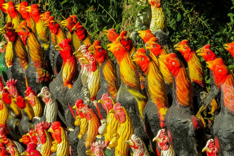 Colorful rooster figure in thai garden stock photo