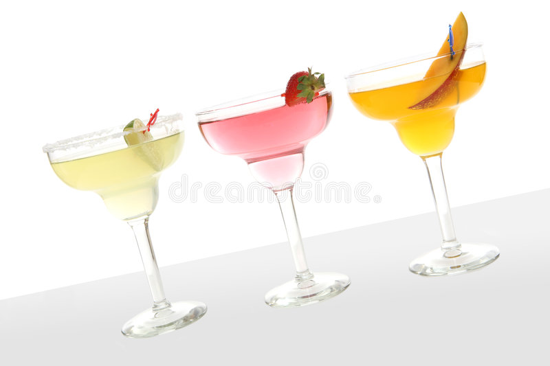 Colorful Cocktails. Three colorful cocktails over a white background stock photos