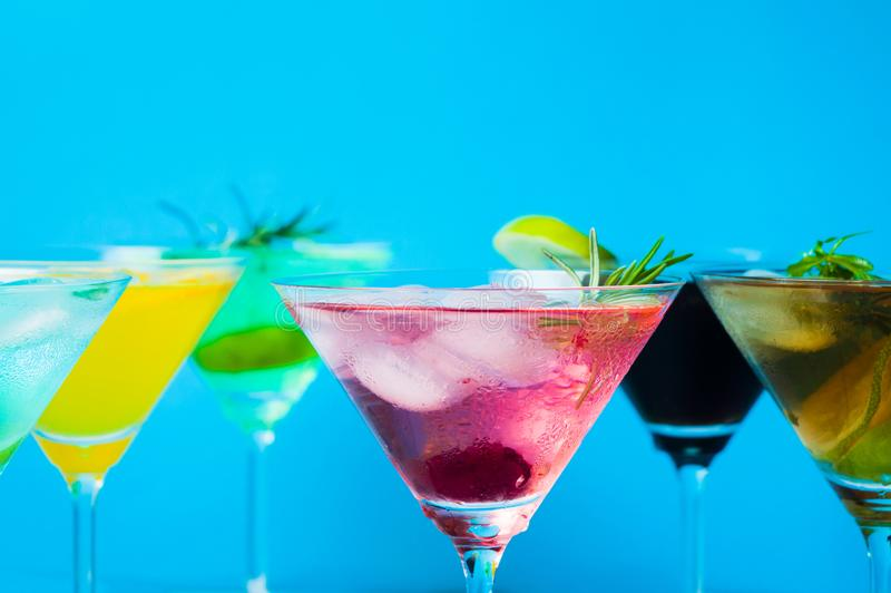 Colorful Cocktails Against Blue Background Stock Image ...