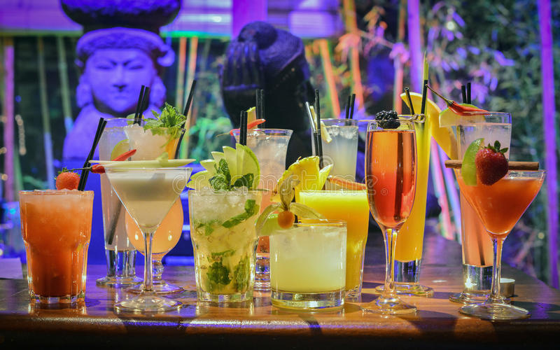 Colorful cocktails on bar stock photo