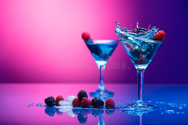 Colorful cocktails garnished with berries. With copy space stock images