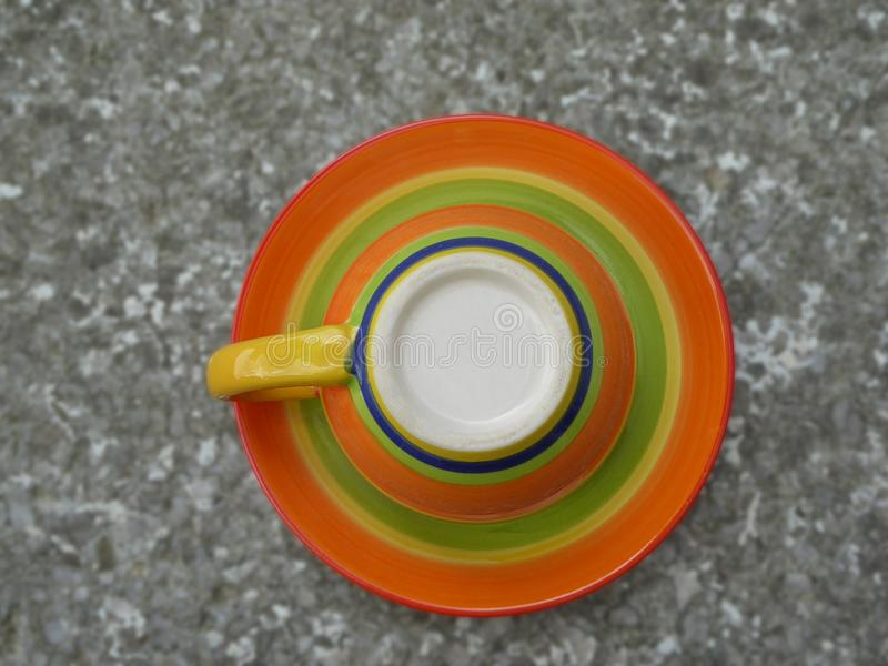 Coffee cup upside down on saucer stock image