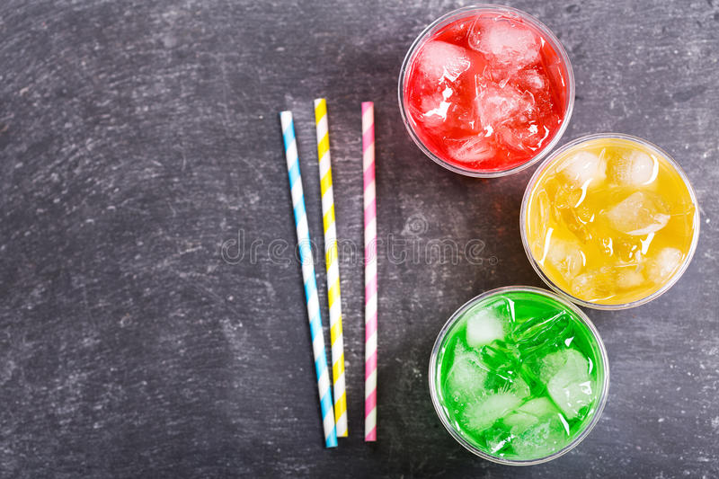 Colorful cold drinks in plastic cups stock photography