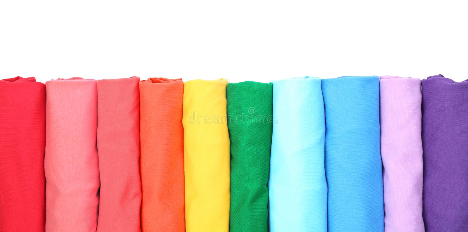 Colorful collection of t-shirts. On white background royalty free stock photos