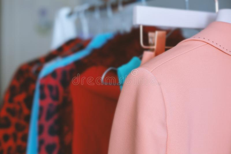 Colorful collection of women`s clothes stock images