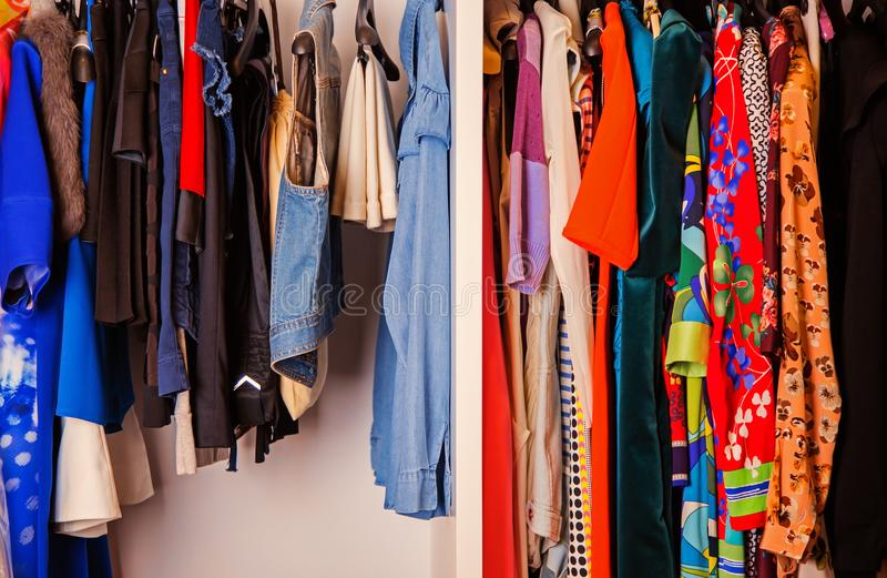 Colorful collection of female clothes hanging on a rack royalty free stock photo