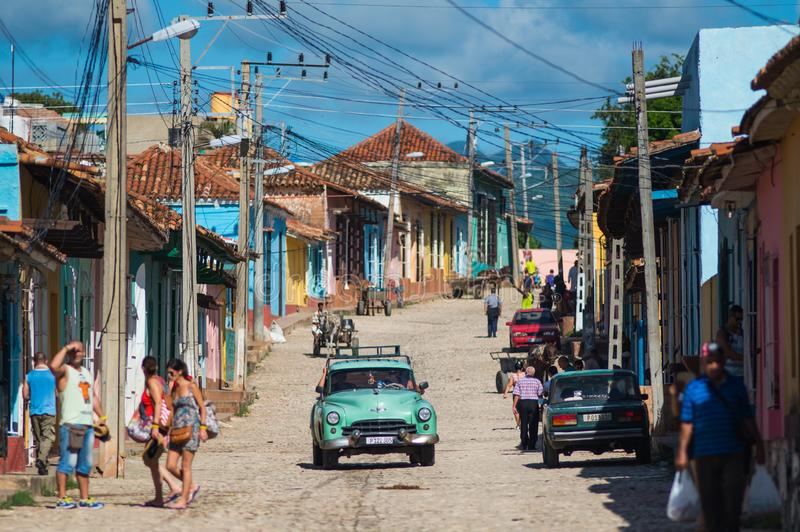 Colorful Colonial Caribbean historic village with cobblestone street, classic car and house, Trinidad, Cuba, America. royalty free stock photos