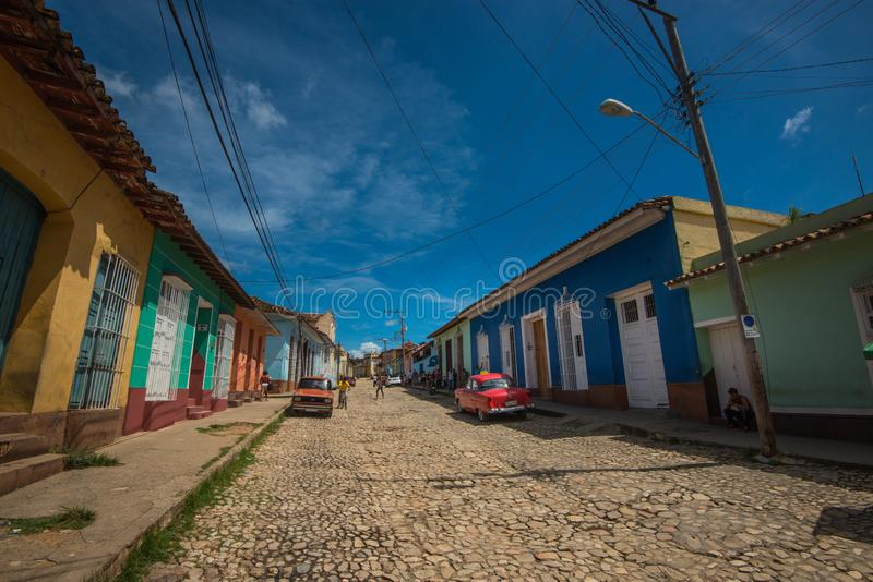 Colorful Colonial Caribbean aged town with cobblestone street, classic car and Colonial house, Trinidad, Cuba, America. stock photography