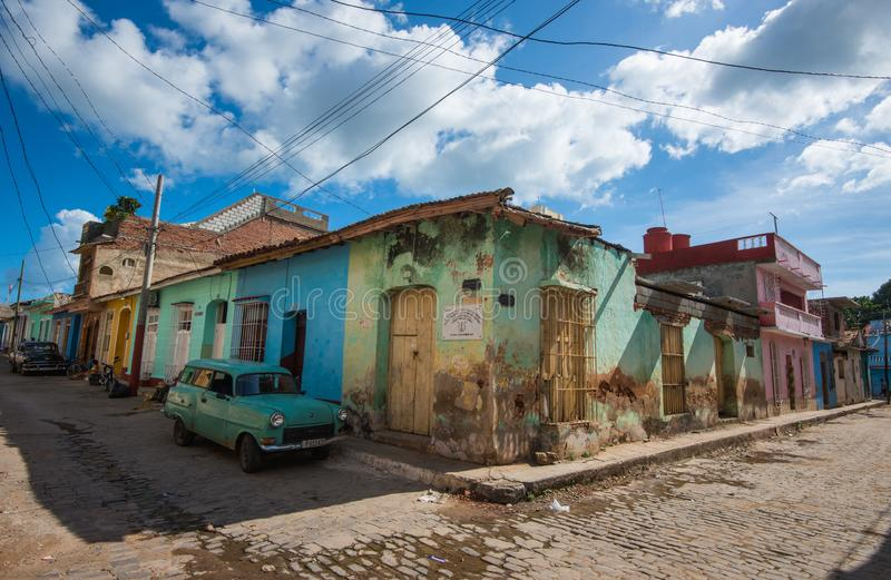 Colorful Caribbean aged village with cobblestone street, classic car and Colonial architecture, Trinidad, Cuba, America. royalty free stock images
