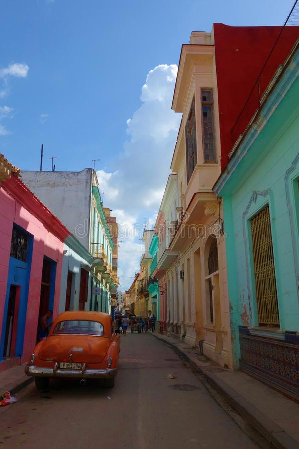 Colorful colonial buildings with old vintage car, Havana, Cuba stock photography