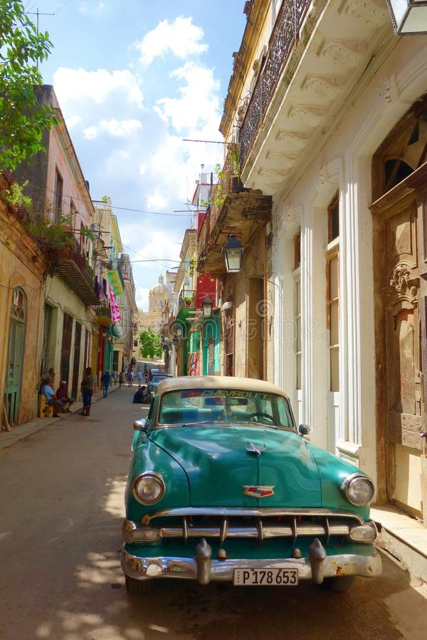Colorful colonial buildings with old vintage car, Havana, Cuba stock image