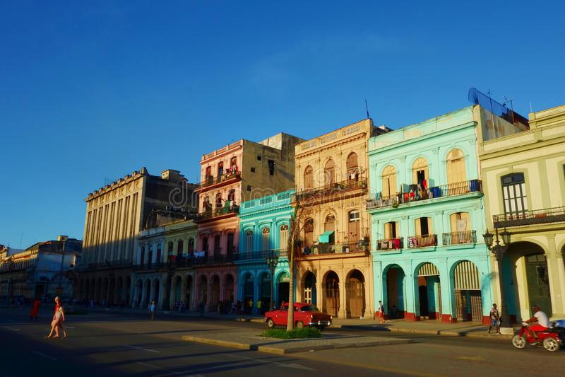 Colorful colonial buildings with old vintage cars, Havana, Cuba stock photo