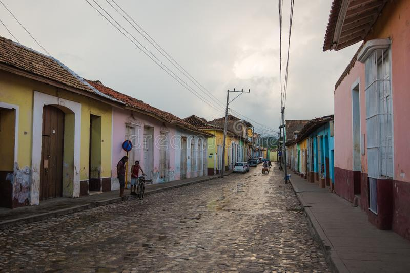 Colorful Colonial Caribbean historic town with old cobblestone street, people and house, Trinidad, Cuba, America. stock images
