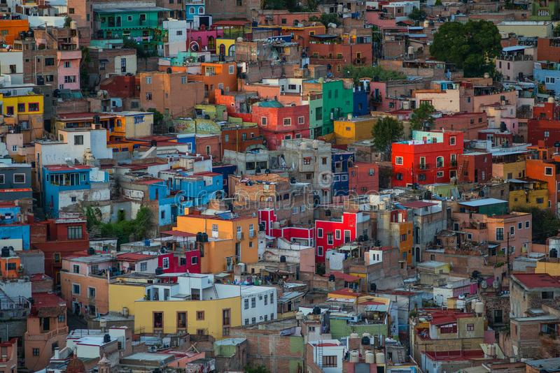 Colorful colonial crowd American city and buildings in hill, Guanajuato, Mexico. Colorful colonial architecture building in hill, which was built in silver royalty free stock photography