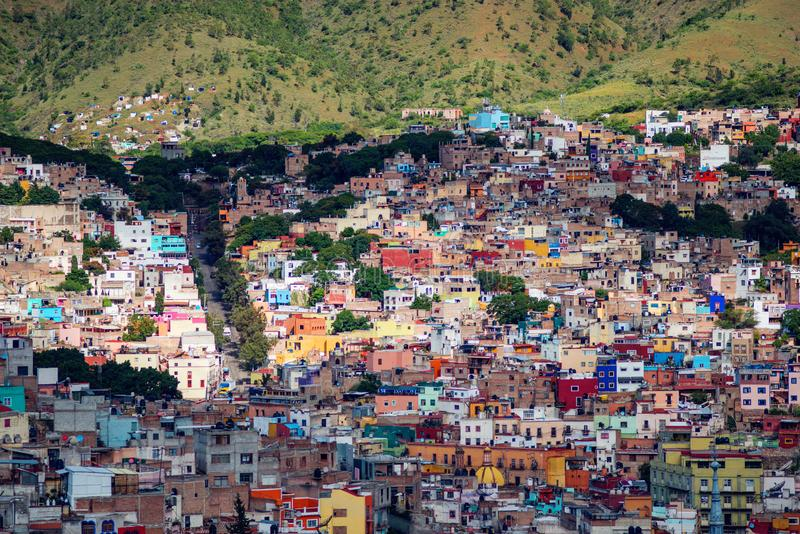 Colorful colonial crowd American city and buildings in hill, Guanajuato, Mexico. Colorful colonial architecture building in hill, which was built in silver stock photos