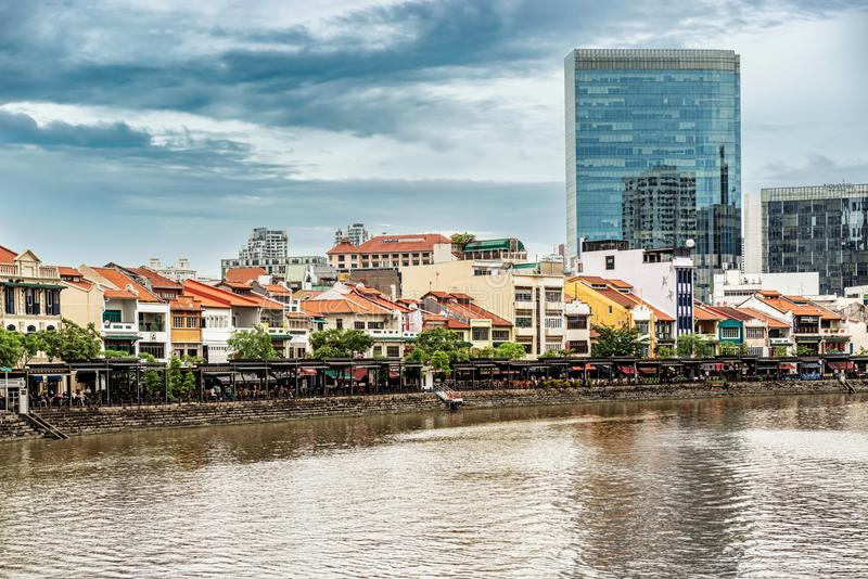 Colorful colonial houses along Singapore river in Singapore. Singapore - Jan 14, 2018: Colorful bars, restaurants and stores by the Singapore River along Clarke stock photography
