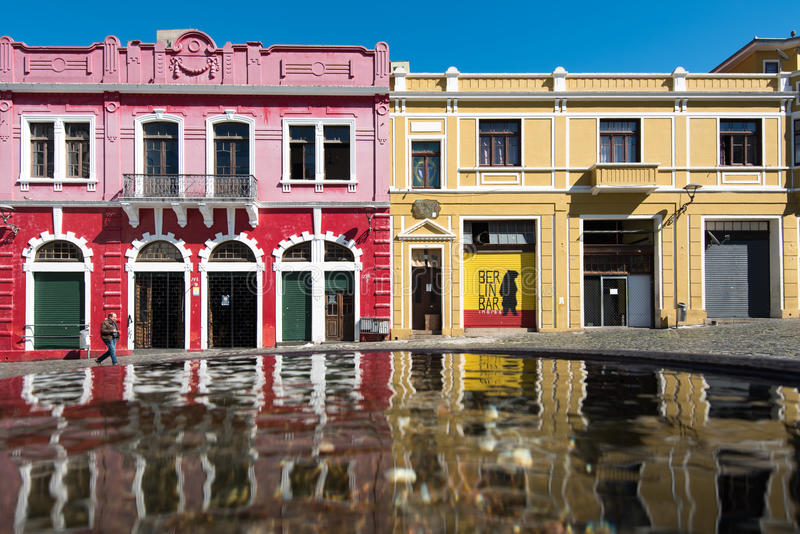 Colorful Colonial Houses of Curitiba. Curitiba, Brazil - July 21, 2017: Colorful colonial houses of the historic park of the city reflected in water royalty free stock photos