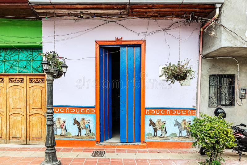 Colorful colonial houses on a street in Guatape, Antioquia in Co. Guatape, Colombia - March 27, 2018: Colorful colonial houses on a street in Guatape, Antioquia royalty free stock photos