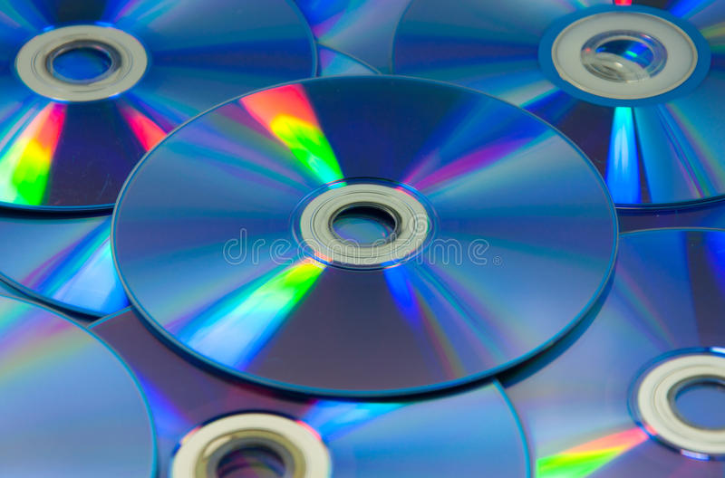 Colorful compact discs set of DVD scattered on a table stock photos