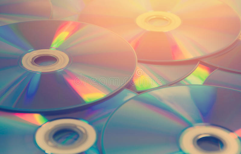 colorful compact discs set of DVD scattered on a table stock photo