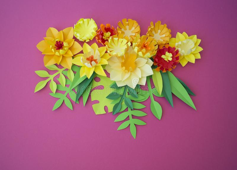 Colorful composition of handmade paper on a wood background. Papercraft flower. stock image