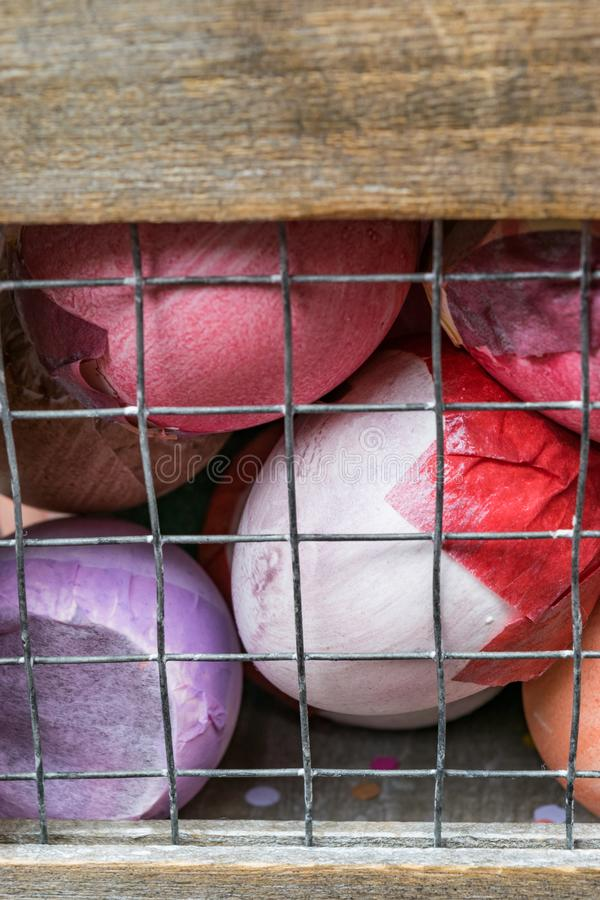 Painted egg shells in wooden wired container royalty free stock photography