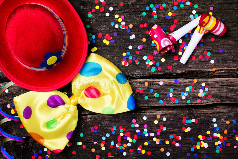 Colorful confetti on wood. Rustic stock photos