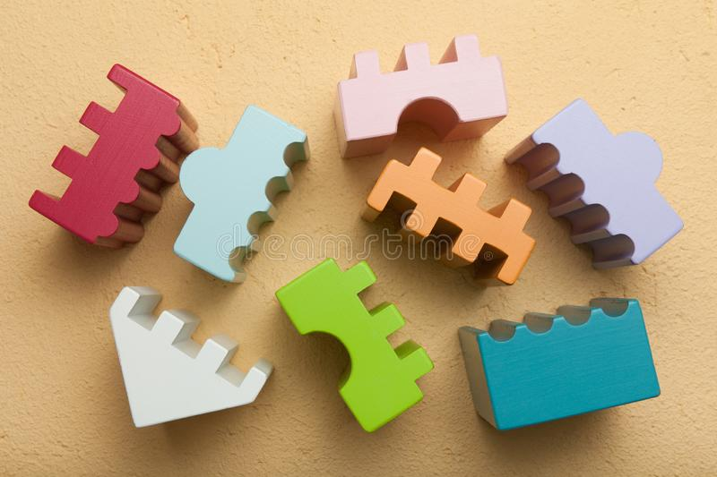 Colorful constructor, logic, mosaic. Brown background stock photo