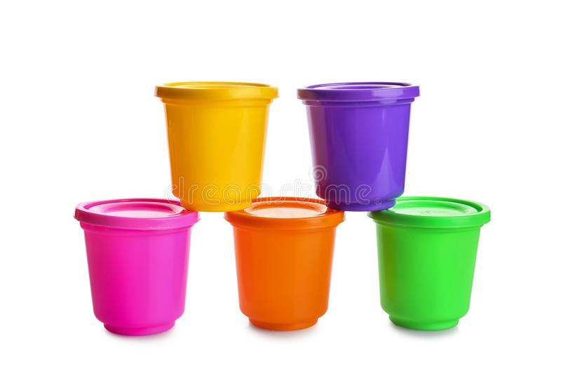 Colorful containers with play dough. On white background royalty free stock photos