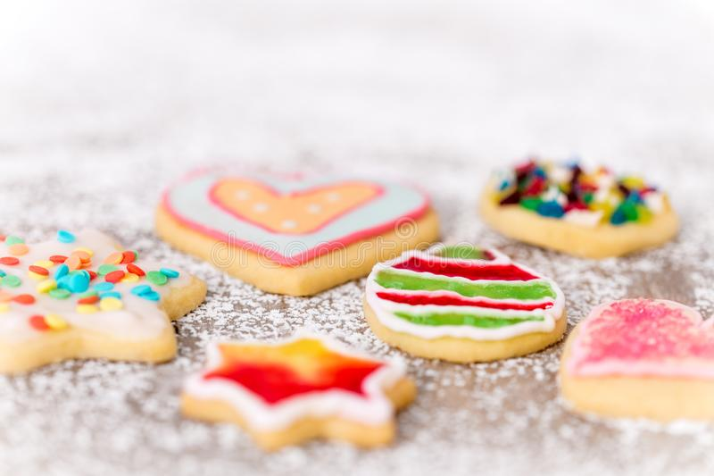 Colorful cookies with dekoration on icing sugar, sweet greeting card. With copyspace royalty free stock image
