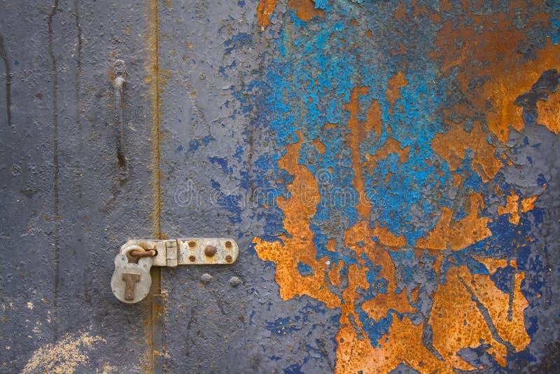 Colorful corroded metal door