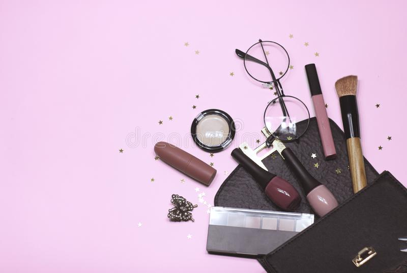 Colorful cosmetic set on pink background with stars, flat stock image