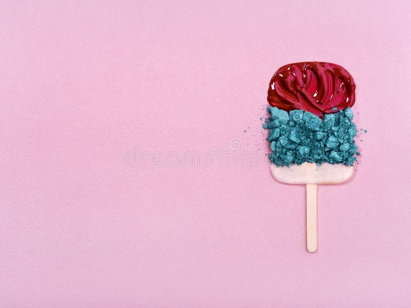 Colorful cosmetics arranged in ice cream shape. royalty free stock photos