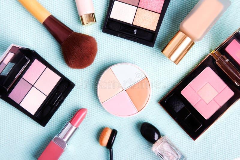 Colorful cosmetics set on blue background. Colorful desorative cosmetics set on blue background stock photo